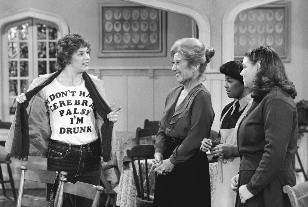 "THE FACTS OF LIFE -- ""Cousin Geri"" Episode 5 -- Aired 12/24/80 -- Pictured: (l-r) Geri Jewell as Geri Tyler, Charlotte Rae as Mrs. Edna Ann Garrett, Kim Fields as Dorothy 'Tootie' Ramsey, Mindy Cohn as Natalie Letisha Sage Green -- Photo by: Ron Tom/NBCU Photo Bank"
